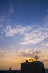 silhouette satellite dish in sunrise sky