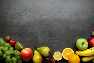Fresh fruits on grey kitchen table