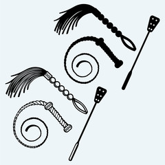 Three different types of whips for sexual role-playing and SM games. Isolated on blue background