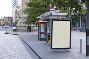 Blank billboard in a bus stop