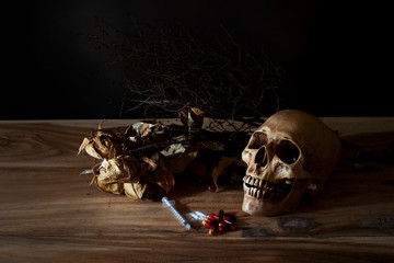 syringe and poison pill with the skull