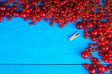 Frame made of berries with wooden clothes pin