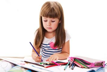 lovely little girl writing at the desk