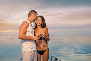 Guy with  girl relaxing on the yacht.