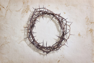 Crown of thorns on textured paper
