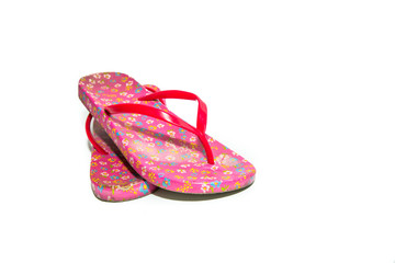 Used pink slippers on white background.