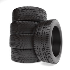 New tires stacked up and isolated on white background