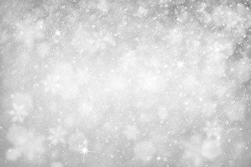 Blurry silver abstract snowflake Christmas and New Year illustration background. Silver color snowfall illustration with copy space background.