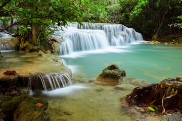 Natural waterfall in deep tropical forest.
