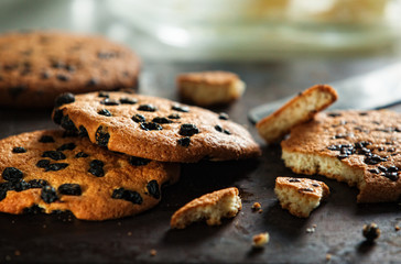 Heap of fresh baked cookies with raisin and chocolate