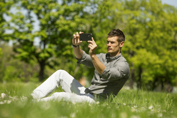 Man Taking Photos Of Landscape With Mobile Smart Phone