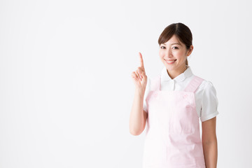 young asian care worker isolated on white background
