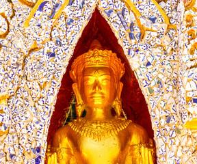 Golden Buddha standing