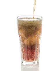 Pouring cola into glass with ice cubes isolated