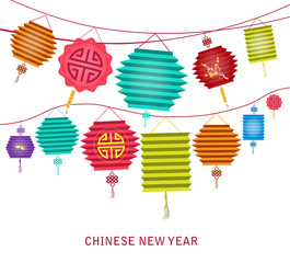 Chinese new year. string of bright hanging lantern decorations on white