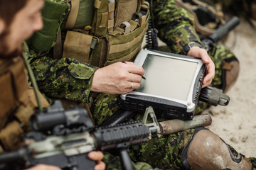 commander of the Rangers paves the route on an electronic satnav