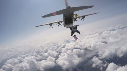Acrylic Prints Sky sports Wingsuit exit from c130J hercules