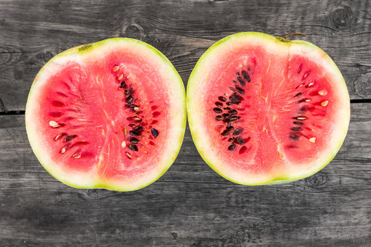 Two pieces of cut in half ripe fresh watermelon