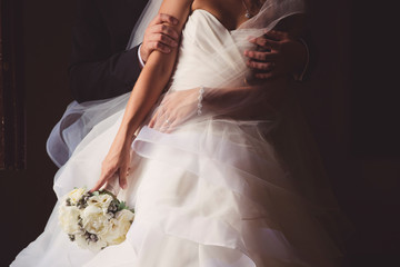 Bride in a tender embrace groom