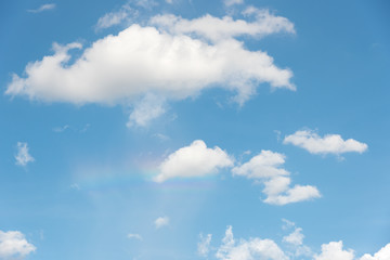 Rainbow in blue sky