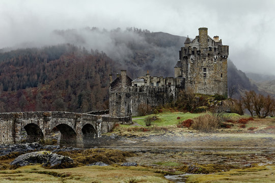Famous Eilean Donan Castle in Spring misty morning, one of the most popular monuments in Scotland
