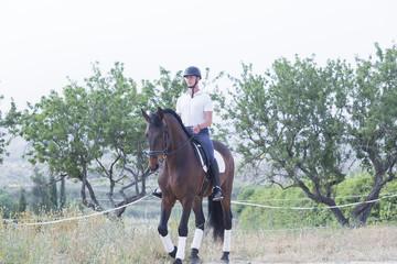 boy riding a horse.