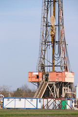 oil drilling rig and equipment on field