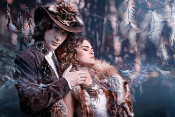 Man and woman in a mystical forest.