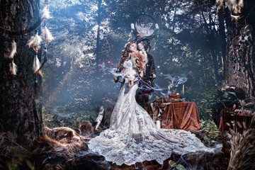Woman model bride in a mystical forest.