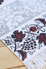 Towel for the icon with the red-black Ukrainian embroidery, selective focus