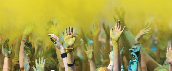 Raised hands up at the festival of Holi