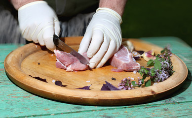 Fresh raw meat on a platter with herbs