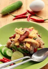rice fired with pork,vegetable,egg,chilli on wood background.