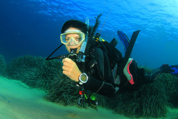 Beautiful woman scuba diving