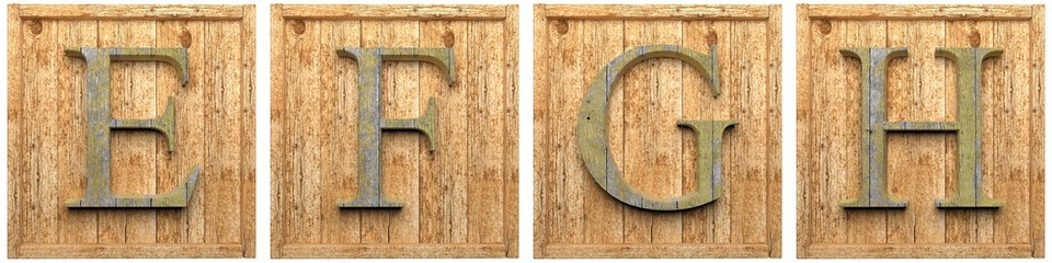 Group of wooden letters E F G H framed, isolated on white
