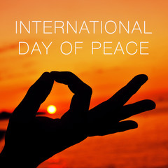 hands in gyan mudra and text international day of peace