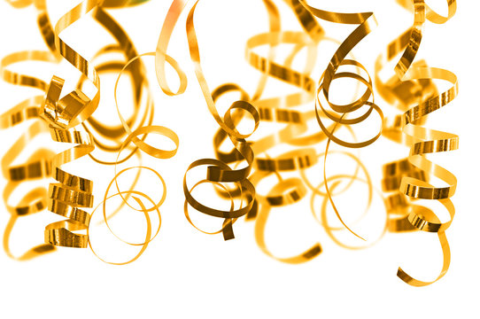 Golden serpentine streamers hanging on white background