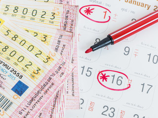 Close up Thai lottery tickets and Thai calendars