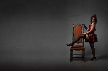 burlesque woman play with chair