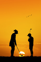 couple plays golf