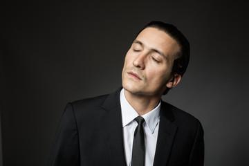 attractive man in black suit