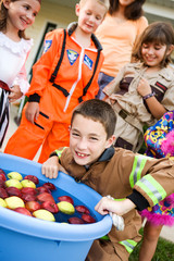 Halloween: Boy Bobbing for Apples