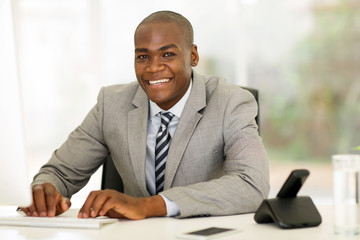 afro american businessman using computer in office