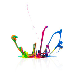 Colorful paint splashing on white