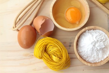 Making yellow noodle with egg and wheat flour.