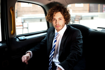 Handsome business corporate inside taxi