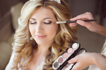 Beautiful bride girl with wedding makeup and hairstyle. Stylist Wall mural