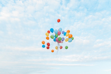 A bunch of colorful balloons flying in the sky