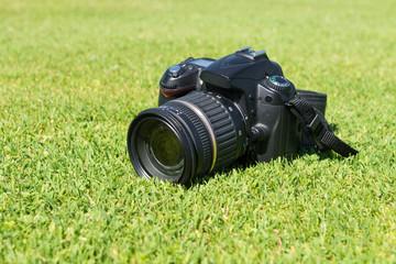 SLR camera on a green lawn