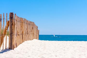 Fence on beach